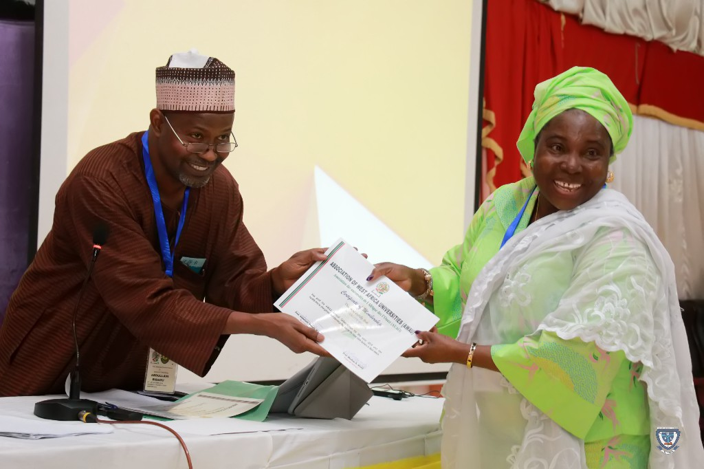 Presentation of Certificate to the Vice-Chancellor, Prof. Angela F. Miri during the 7th Conference and 9th AGM of the Association of West Africa Universities held in Benin Republic